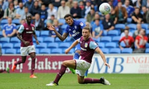 Cardiff City's Nathaniel Mendez-Laing scores his side's third goal, curling around the Aston Villa defender James Chester.