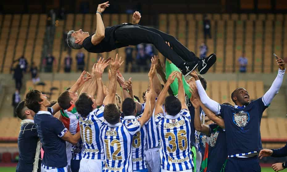 Real Sociedad's players toss Imanol Alguacil into the air after their victory against Athletic Bilbao in the Copa del Rey final.