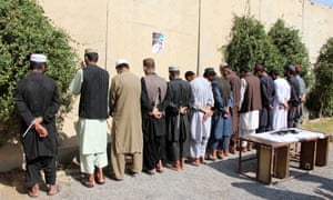 Afghan security officials present a group of suspected militants to the media during a news conference in Kandahar, Afghanistan.