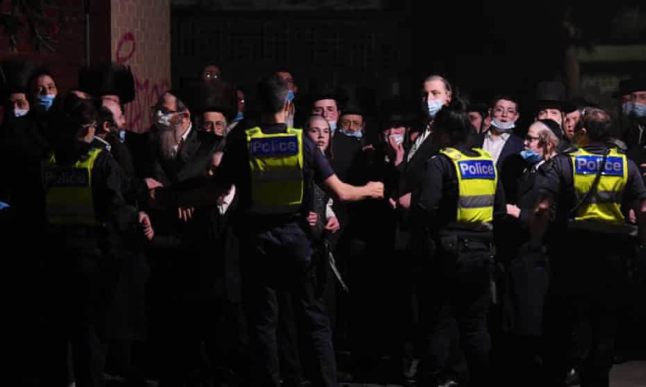 Police control a crowd outside a building near a Ripponlea synagogue in Melbourne on Tuesday