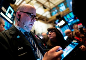 Traders work after the opening bell at the New York Stock Exchange today