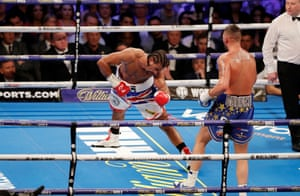 Haye's legs buckle as he heads to the floor in the fifth.