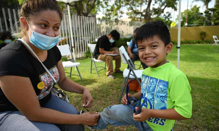Rosa Gallagos with her son Herrick after she received her first vaccine dose at a community healthcare event in a predominately Latino neighborhood in Los Angeles in August.