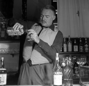 'Reminder of normal life' … Ernest Hemingway pouring himself a gin in 1948.