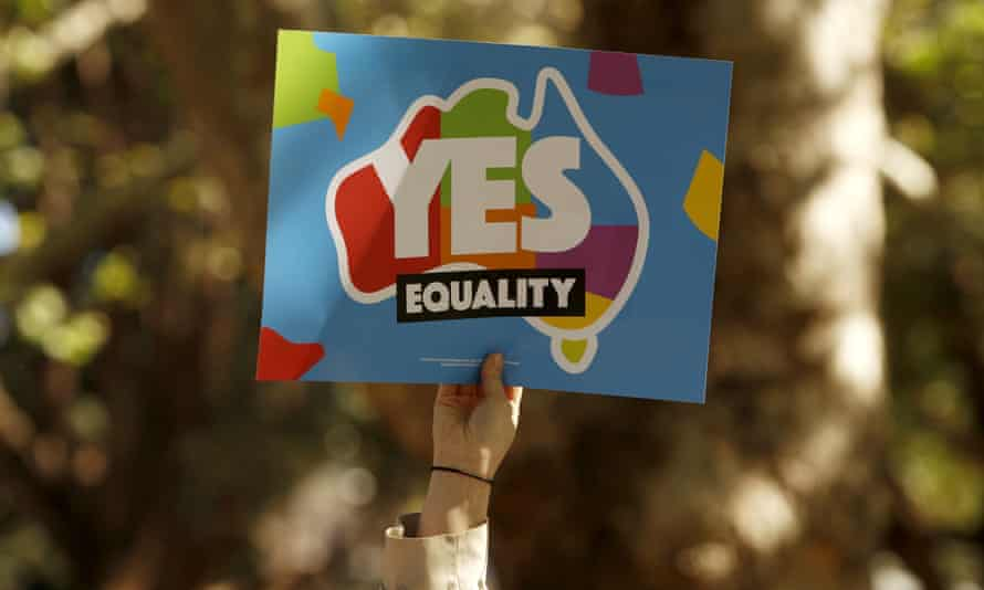 A marriage equality supporter in Sydney hold a placard.