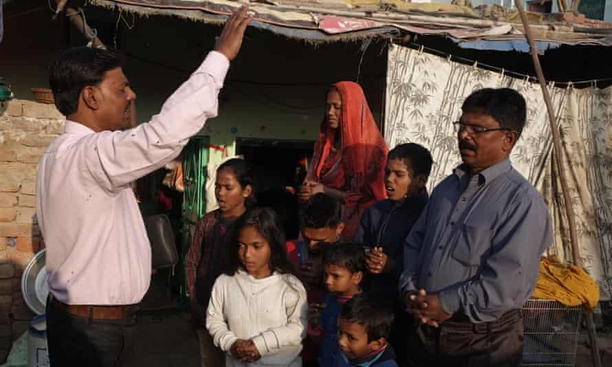 """Christian pastor Rajpal Samuel with a first generation Christian family. Hindu groups claim that pastors, are forcibly converting Hindus to Christianity. Pastor Samuel said such charge is baseless. """"If people are embracing Christianity they are doing it purely of their own free will."""""""