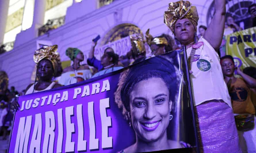 Carnival revellers hold a banner that reads 'Justice for Marielle' in Rio de Janeiro