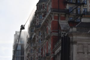 London, England Firefighters tackle a blaze at the Mandarin Oriental hotel in central London