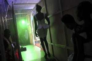 A model prepares to walk onto the catwalk during the Festi'Bazin runway show