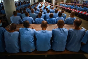 Prisoners wait 30 minutes in case they experience side effects after receiving doses of the Sinopharm Covid-19 vaccine in Chon Buri, Thailand
