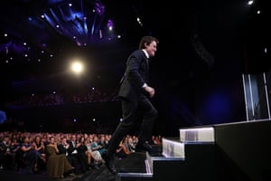 Damon Herriman runs up to the podium to accept an Aacta for his role in Judy & Punch