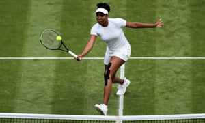 Venus Williams plays a forehand volley at the net in her Ladies' Singles Second Round match against Ons Jabeur of Tunisia.