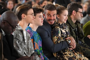 London, UK: David Beckham and his children Romeo, Cruz and Harper take their seats in the front row for the catwalk show by Victoria Beckham at London Fashion Week.