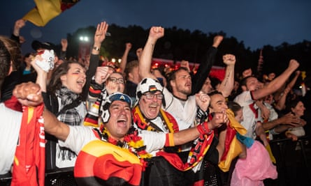 Germany fans watching at the Brandenburg Gate in Berlin celebrate the late World Cup winner against Sweden.
