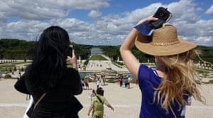 Versailles, FranceTourists take pictures at the gardens of Versailles Palace on a sunny day in France