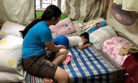 Filipino domestic worker in Hong Kong, Anna-Maria, looking over her baby son, Emmanuel