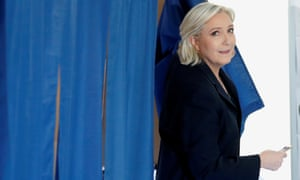 Marine Le Pen leaves a polling booth after voting.