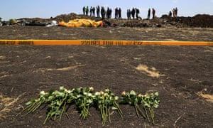 Flowers at the scene of a plane crash in Bishoftu, Ethiopia