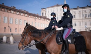 Mounted policemen patrol in Turin, Italy
