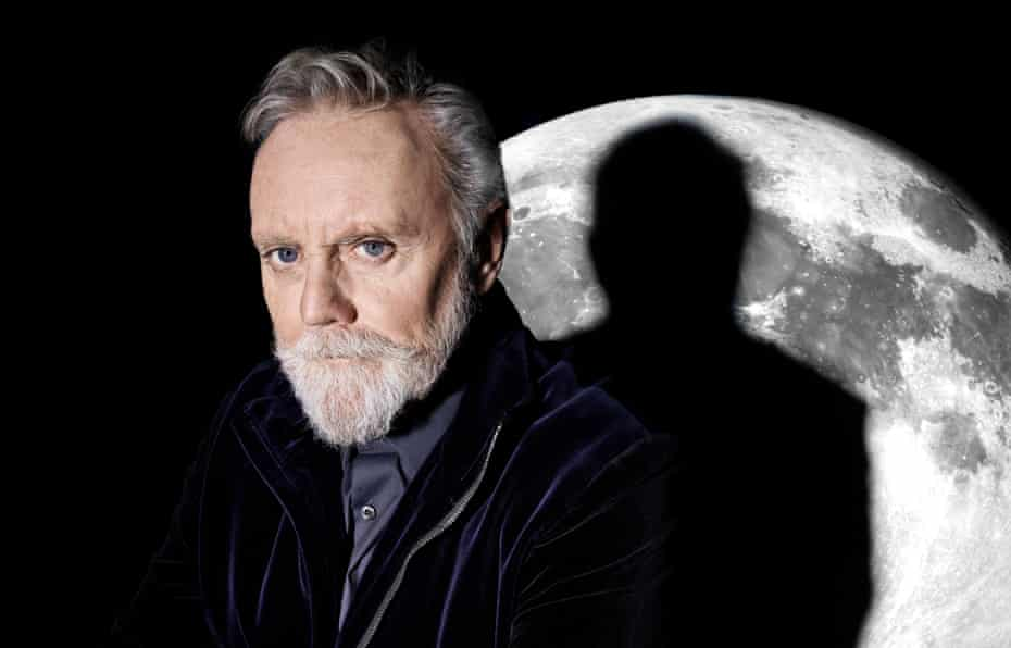 Queen drummer Roger Taylor, with shadow across moon backdrop