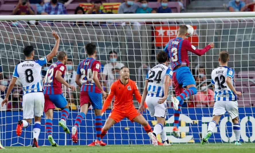 Gerard Pique rises highest to nod in Barcelona's opener.