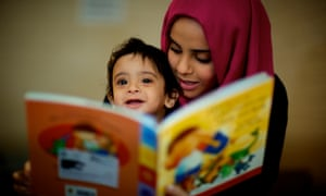 Children and parents reading together at the Imagination Library at the Coleridge Children's Centre in Rotherham.