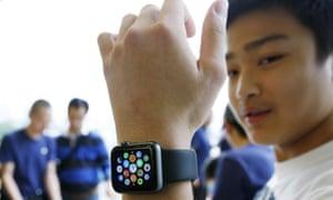 A customer tries on an Apple Watch in Hong Kong