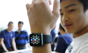 A customer tries on an Apple Watch in Hong Kong.