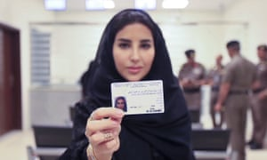 Esraa Albuti shows off her new driving licence at the traffic department in Riyadh on Monday
