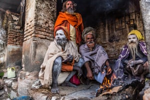 On a chilly morning at the Pashupatinath Temple, outskirts of Kathmandu, sadhus keep warm by the fire.