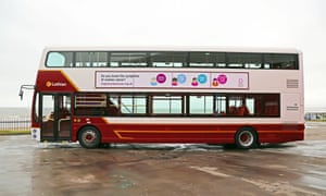 A double-decker bus highlighting the symptoms of ovarian cancer
