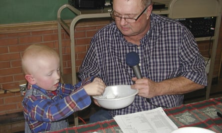 Eric Kuhlman, three, helps master of ceremonies Stan Miller draw names for the annual Norcatur Christmas drawing.