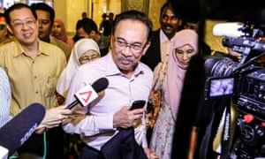 Malaysian opposition leader Anwar Ibrahim talks to media as he arrives at the Palace of Justice in Putrajaya, Malaysia. Ibrahim was found guilty after Malaysia's Federal Court upheld a conviction on charges that he sodomised his former male personal aide.