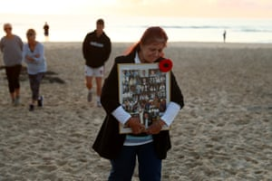 A woman on Currumbin beach to commemorate Anzac Day.