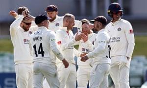 Matt Parkinson (C) of Lancashire is congratulated after taking the wicket of Matt Milnes