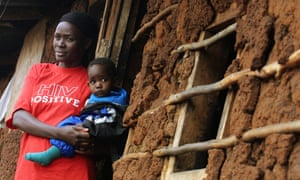 A Kenyan AIDS victim holds her child outside her mud shack on July 19, 2005 at her shack in Kibera, Kenya's largest slum. As World AIDS Day is marked on December 1, 2008 the fight against the disease remains stymied by the dearth of adequate treatment in poor countries and setbacks in finding an effective vaccine, experts say. AFP PHOTO / TONY KARUMBA (Photo credit should read TONY KARUMBA/AFP/Getty Images)