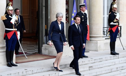 Emmanuel Macron and Theresa May leave the Élysée Palace in Paris.