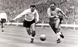 England's Jimmy Armfield puts the pressure on Brazil's Pepe in 1963.