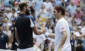 Roger Federer shakes hands with Benoit Paire