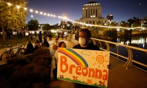 A person holds a sign in remembrance of Breonna Taylor to protest the results of a grand jury indictment in Oakland, California, on 23 September 2020.