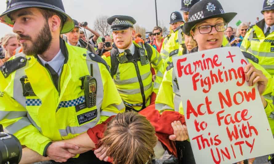 Police arrest a climate activist at the Extinction Rebellion protest on Waterloo Bridge, London, April 2019
