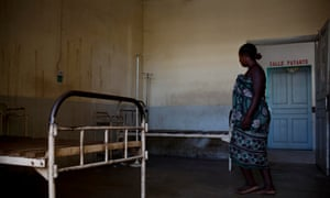 A woman walks through a badly maintained hospital ward in the general hospital in Morondava, Madagascar