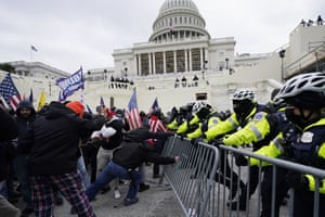 A pro-Trump mob tries to break through a police barrier outside the Capitol.