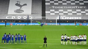 Chelsea players and Tottenham Hotspur players look on as Mason Mount of Chelsea misses his team's fifth penalty in the penalty shoot out, meaning Tottenham Hotspur win their Carabao Cup fourth round match.