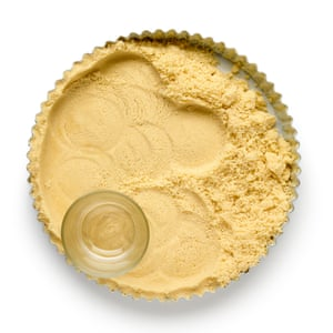Once you've mixed the butter, flour and sugar to crumbs, pack them into a tart case and blind bake.