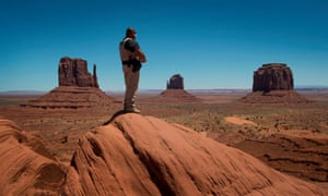 A Navajo park ranger looks out over Navajo Nation-managed Monument Valley Tribal park in Arizona.