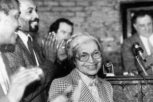 Rosa Parks smiles while people gathered around her applaud at a ceremony held in her honour at the House of the Lord Church, in Brooklyn, New York in 1988.