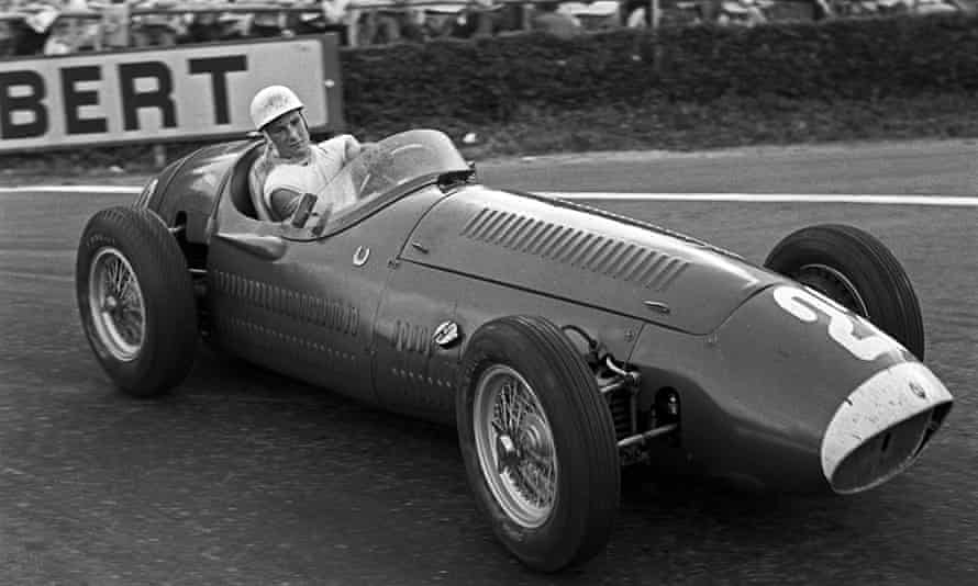 Stirling Moss competing in the 1954 Belgian Grand Prix in a Maserati 250F.