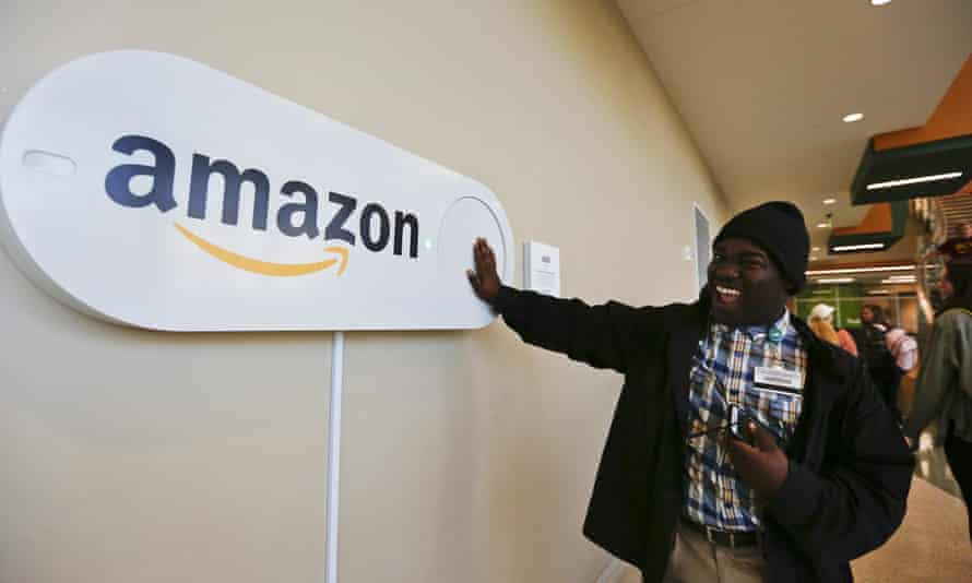 A student at the University of Alabama pushes a large Amazon Dash button, which was part of Birmingham's campaign to lure Amazon's second headquarters.