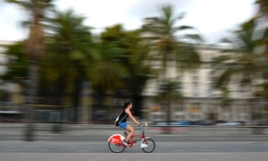 A woman rides on a cycle from Barcelona's Bicing service.